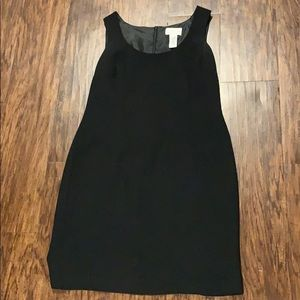 Black shift dress with a small slit in the back